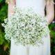 Flower girl flowers at South Farm wedding venue in Royston, Hertfordshire