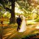 bride and groom walking along shenley cricket club