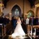 bride walking dow the aisle at st ethaldredas