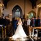 bride walking down the aisle at St Ethaldredas church, Hatfield