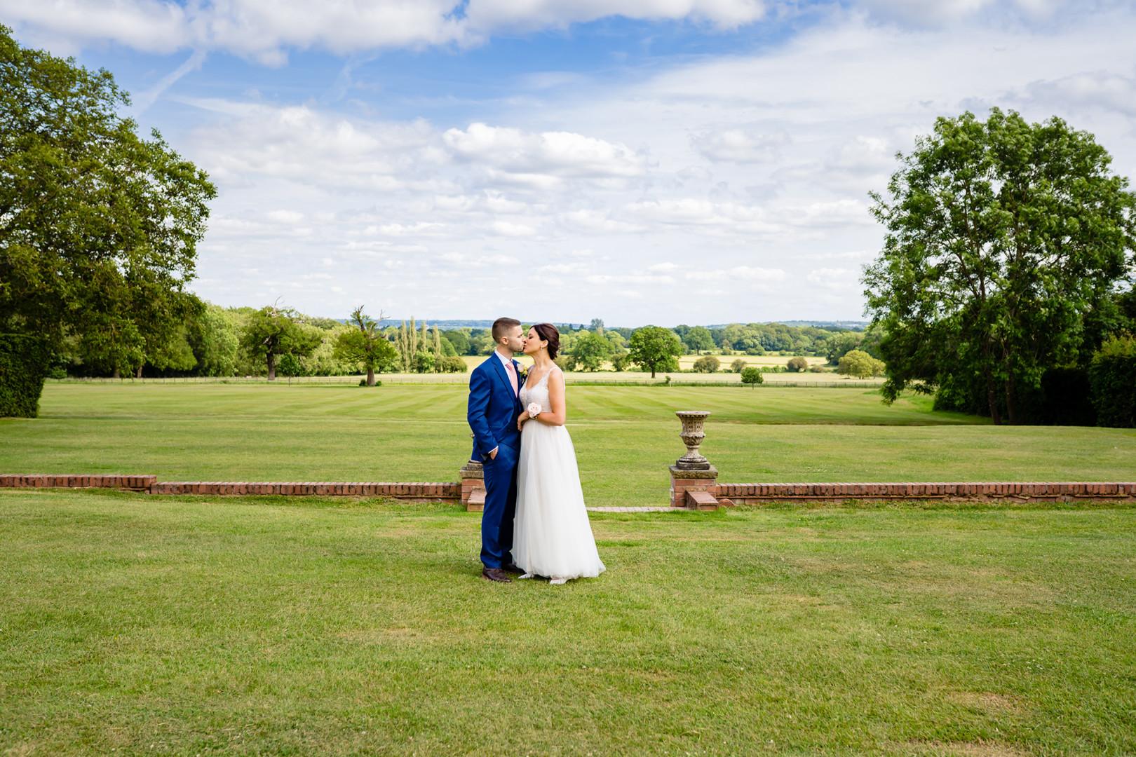 bride and groom at Micklefield Hall wedding venue in hertfordshire